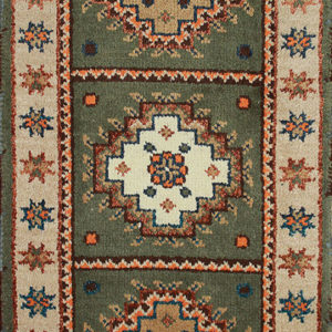 Green Kazak area rug