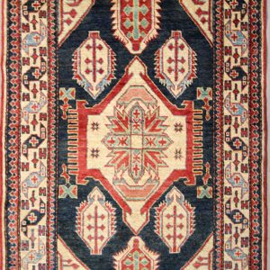 navy blue Kazak rug